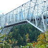 Bridge of the Gods. Columbia River, Washington/Oregon and Skamenia Lodge, WA : The Bridge of the Gods spans the Columbia River near Stevenson, WA. North side is WA, South side is OR. Speed limit is 15 mph. Good thing, because I was totally enchanted by this bridge the first time I crossed it. The views up and down the river are just gorgeous! The Bridge is also the lowest point of the Pacific Crest Trail. I dropped off my friend at the hotel and came right back to drive over it again. The photos are not that good as it was almost dark by the time I got to the bridge. (The last 6 pix are from my Iphone). But I will return to this divine bridge! Learn more: http://byways.org/explore/byways/2141/places/12113/  PCT: http://en.wikipedia.org/wiki/Pacific_Crest_Trail. Skamenia Lodge: http://www.skamania.com/